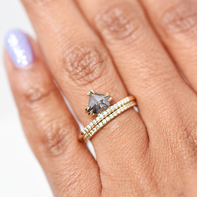 Juno Salt & Pepper Shield Diamond Engagement Ring modeled on hand with a stacking wedding band