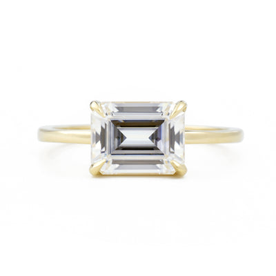Eva East West Emerald Cut 1.75ct Moissanite Engagement Ring in yellow gold