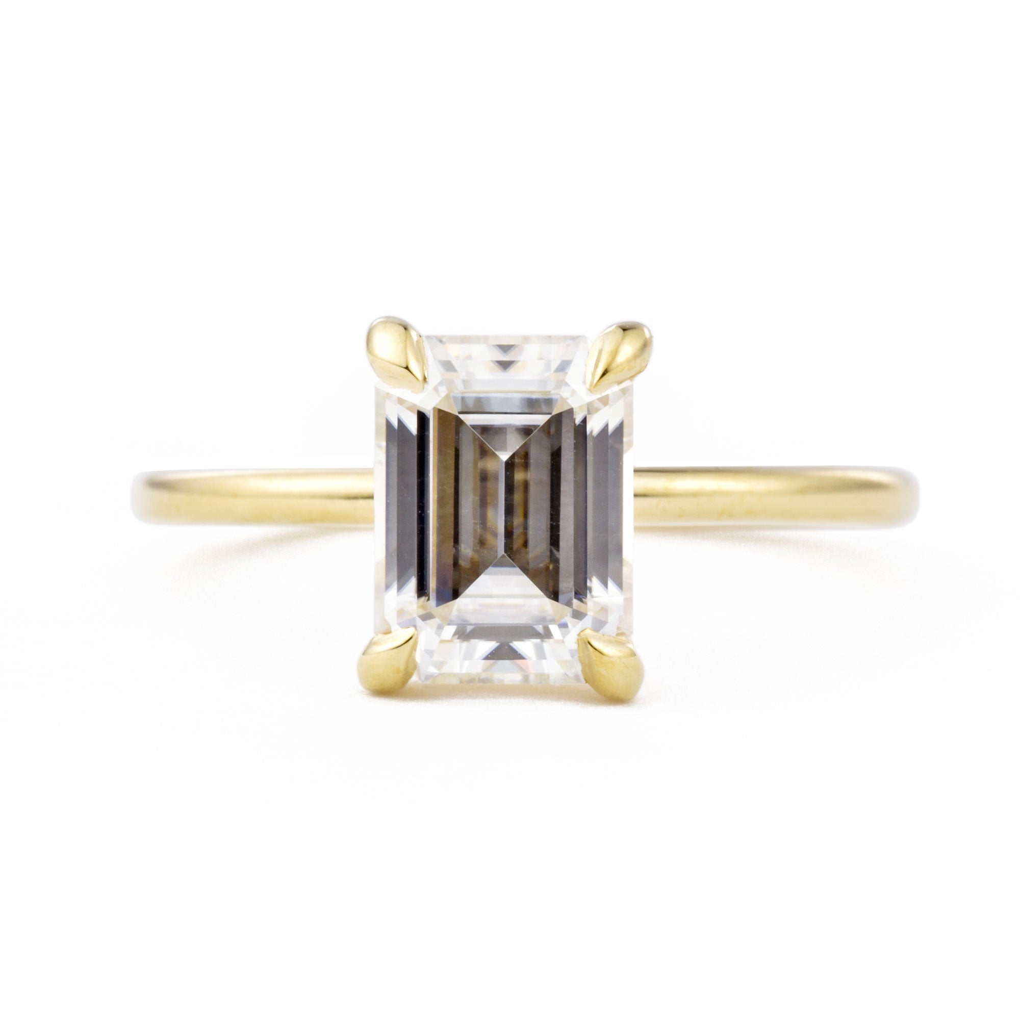 Vera 1.75ct Emerald Cut Moissanite Solitaire Engagement Ring in yellow gold shown from the front