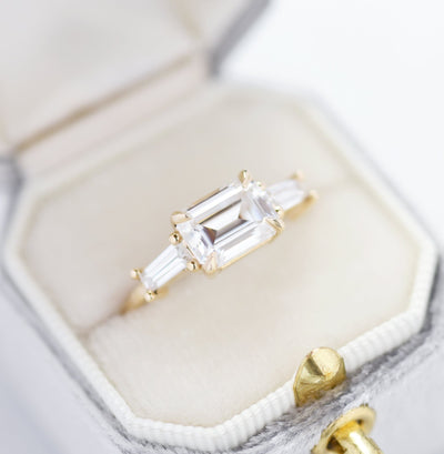 Three Stone Baguette Engagement Ring in a ring box