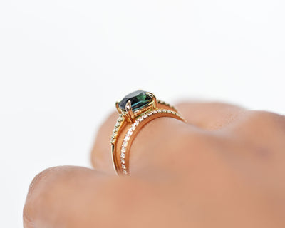 Engagement-ring-va-with-pave-diamonds-teal-sapphire-cushion