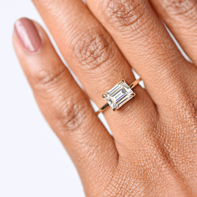 Eva East West Emerald Cut 1.75ct Moissanite Engagement Ring modeled on hand