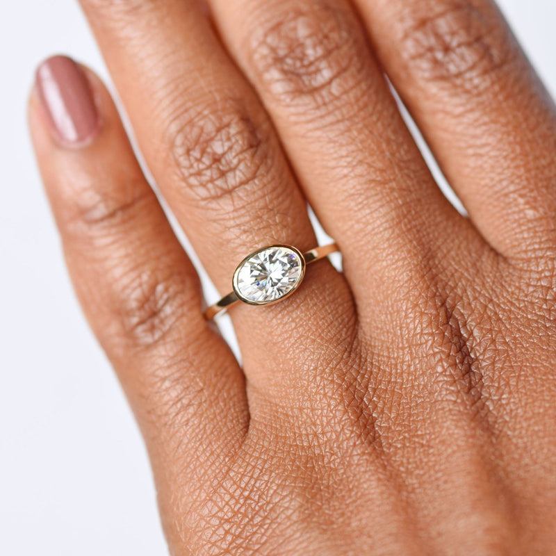 Aura East West Oval Bezel 1.5ct Moissanite Engagement Ring