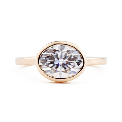 Aura East West Oval Bezel 2ct Moissanite Engagement Ring in rose gold