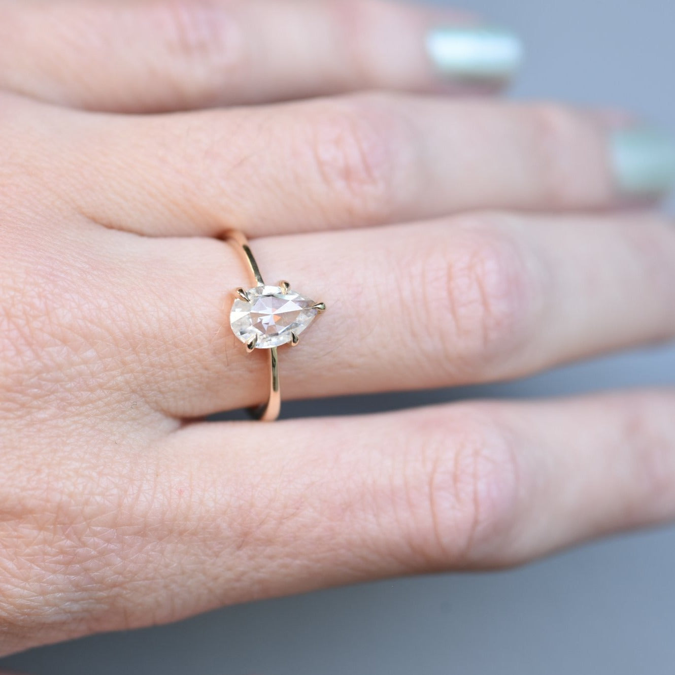 Eva Rose Cut Pear Moissanite Engagement Ring from the front in yellow gold
