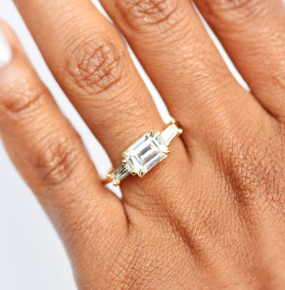 Three Stone Baguette Engagement Ring modeled on hand