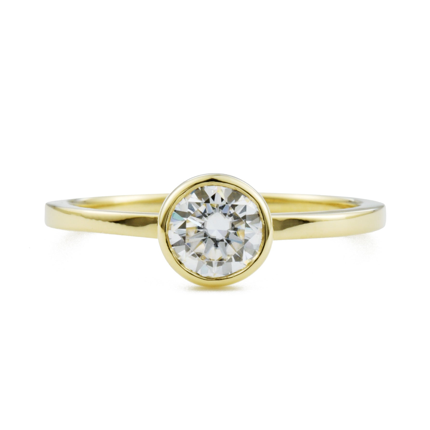Aura Round Bezel .5ct Moissanite Engagement Ring in yellow gold