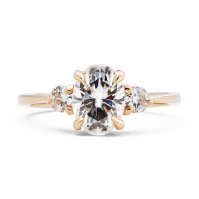 Zara Oval Three Stone Moissanite Engagement Ring in rose gold