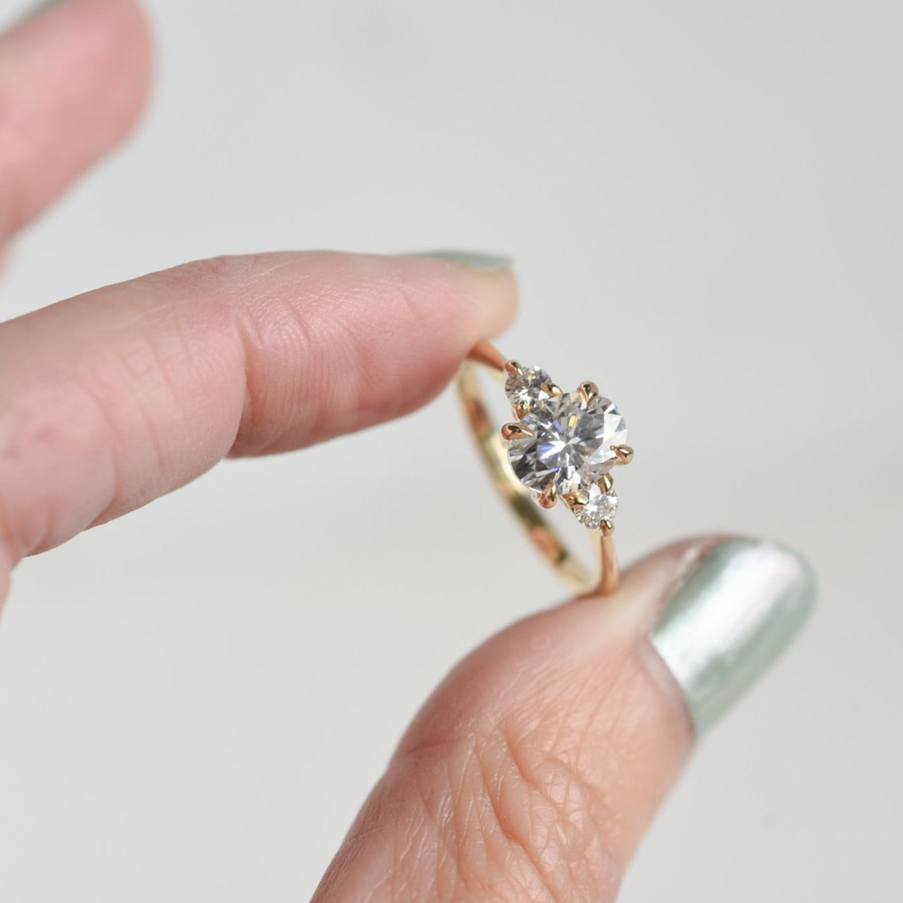 Zara Oval Three Stone Moissanite Engagement Ring in yellow gold