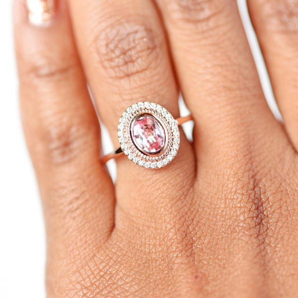 Selena Pink Oval Sapphire and Diamond Halo Engagement Ring