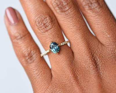 Eva Teal Oval Sapphire Diamond Engagement Ring with Pavé Diamonds