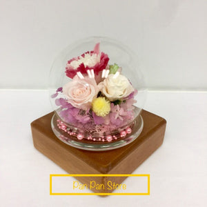 Elegant Sphere Arrangement with Glass Container