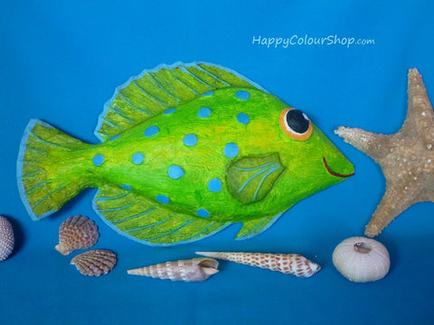 Smiling green papier-mache fish with turquoise dots