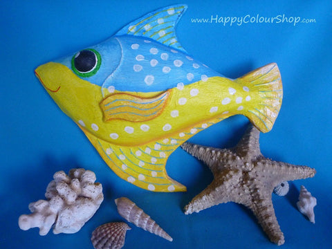 Smiling blue and yellow fish with white dots