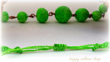 green macrame necklace made with handmade green papermache beads