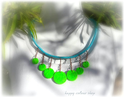 neon green handmade papermache beads on a blue wrapped rope necklace