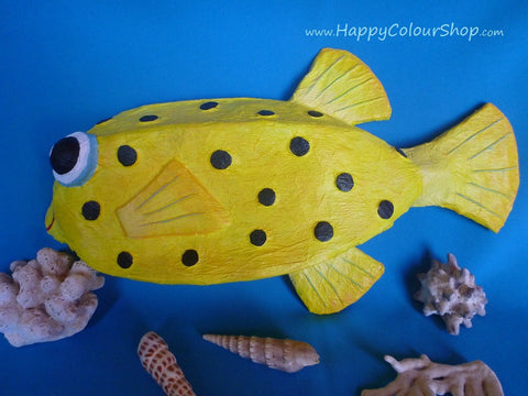 Smiling yelow pufferfish with black dots