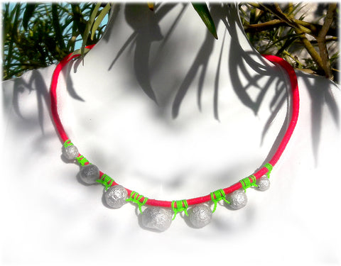 silver paper mache beads from recycled paper, on a pink wrapped cord necklace