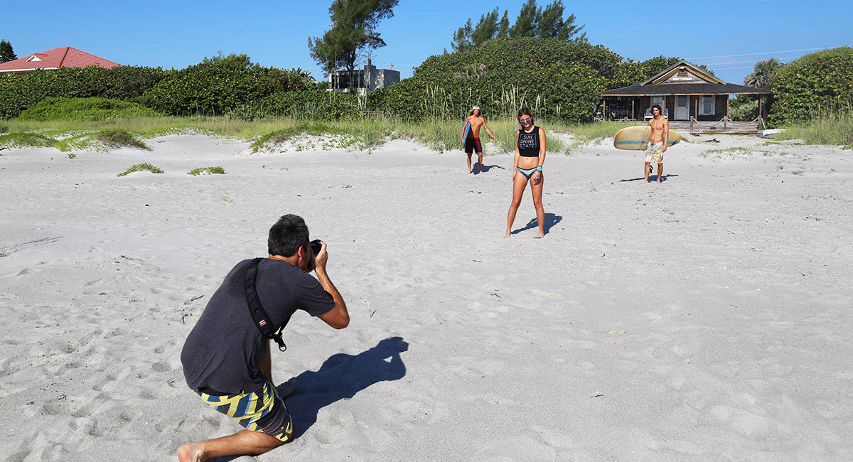 Photographer Zach Ashton shooting on the beach at Driftwood