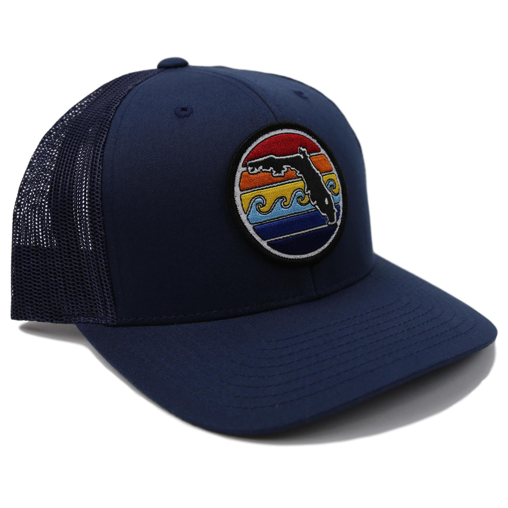 91dcd72f8d7 FLORIDA SUNSET YUPOONG TRUCKER HAT - ALL NAVY – Sunshine State®