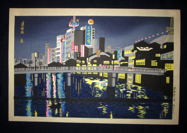 "This is a very beautiful and original Japanese woodblock print ""Night at Dotonbori"" signed by the famous Showa Shin Hanga woodblock print master Tomikichiro Tokuriki (1902-1999) with the ORIIGINAL EDITION chop mark made in 1960s IN EXCELLENT CONDITION."