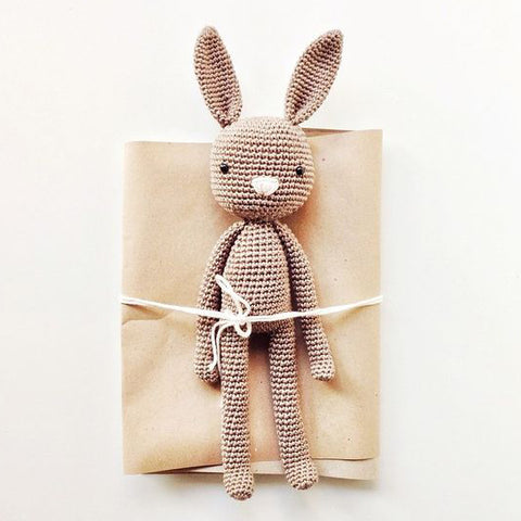 baby toy bunny on baby gift wrapping