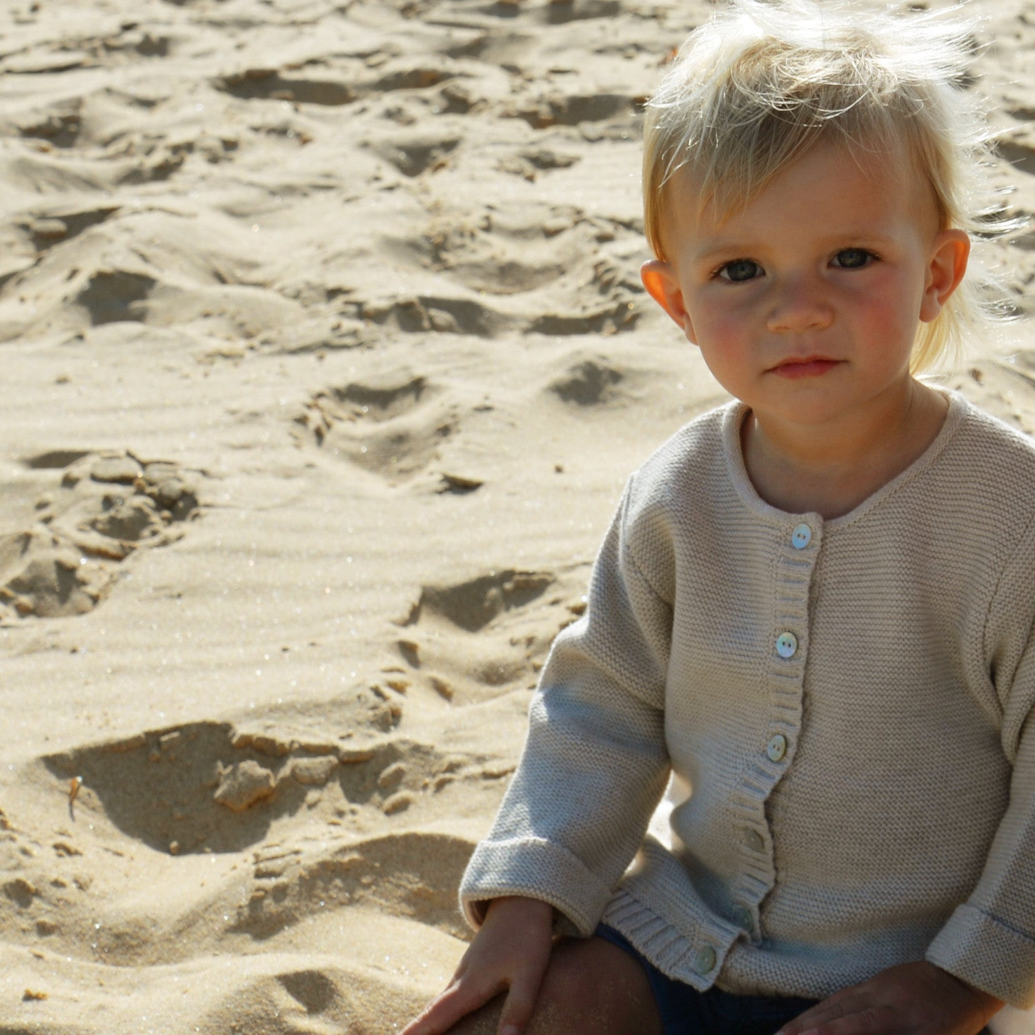 baby set oatmeal cardigan on beach