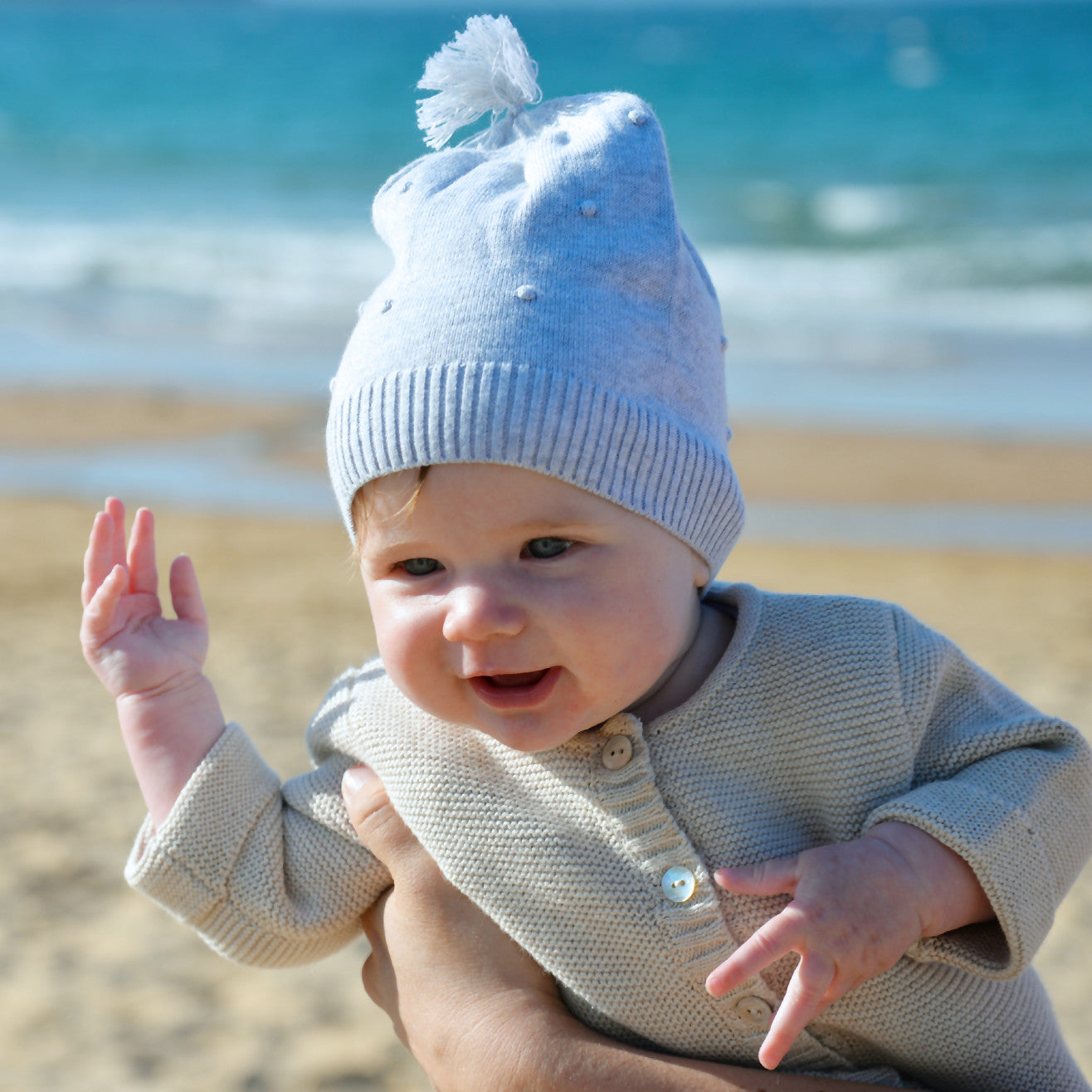 baby in grey marle beanie