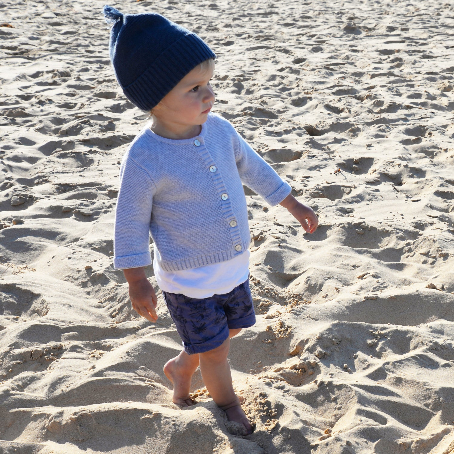 girl on beach in indigo blue beanie