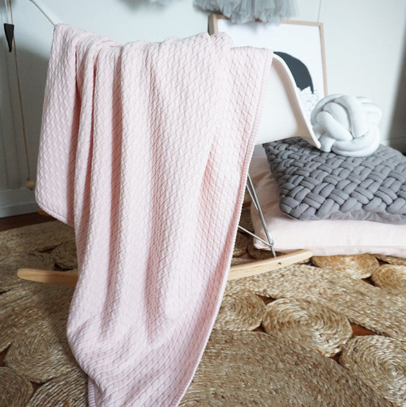 nursery decor with pale pink knit blanket