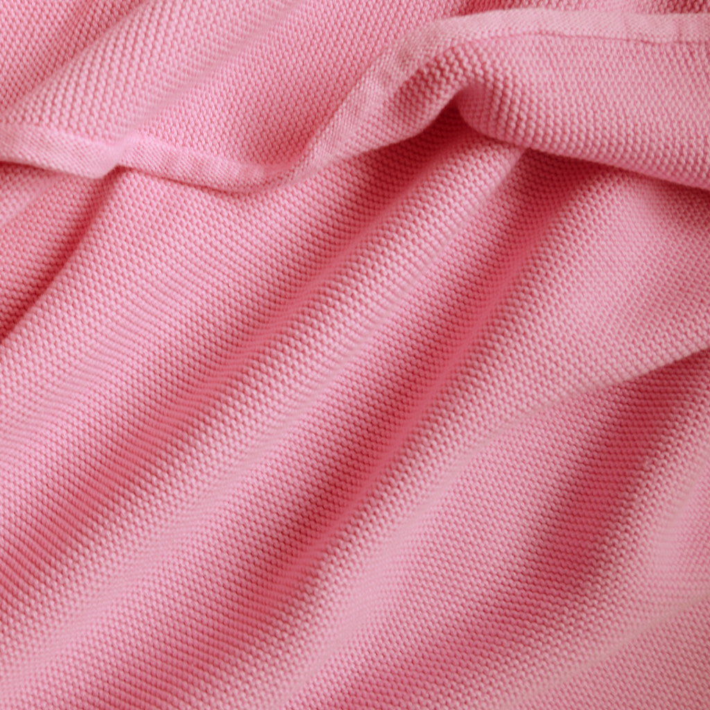 pink knitted baby blanket