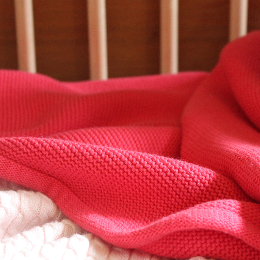 coral pink knit blanket close up