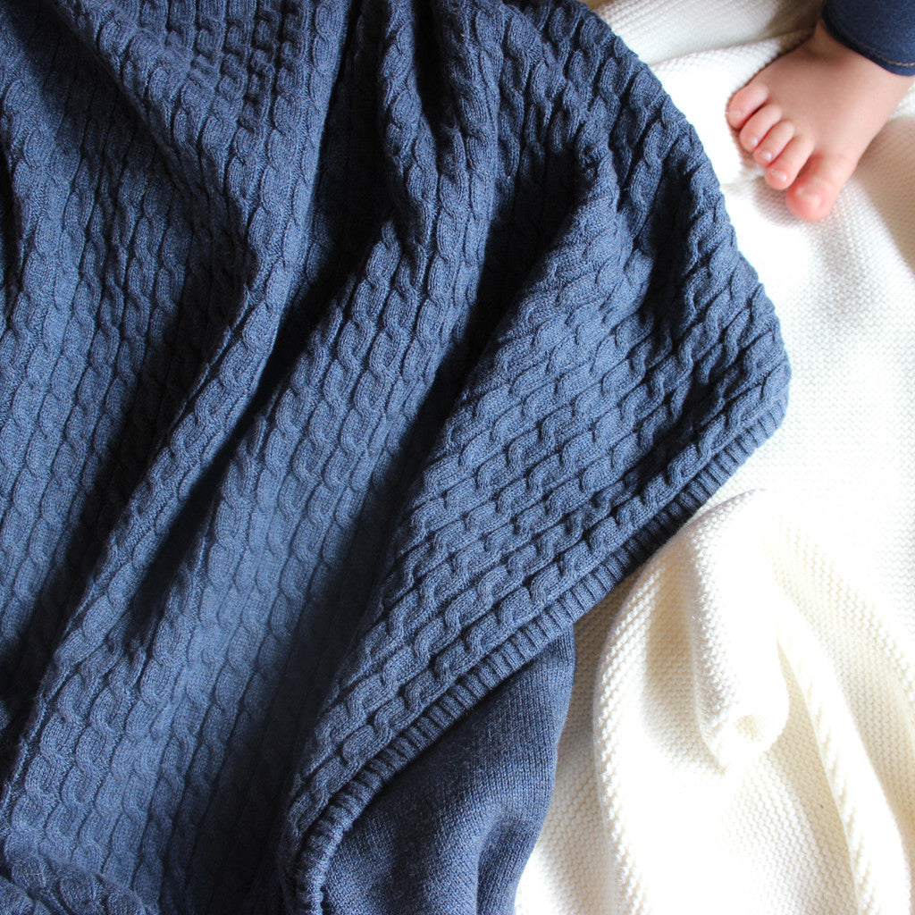 indigo marle blanket with baby feet
