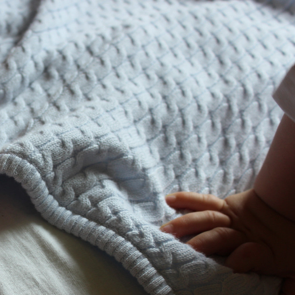 baby blue cable knit blanket close up