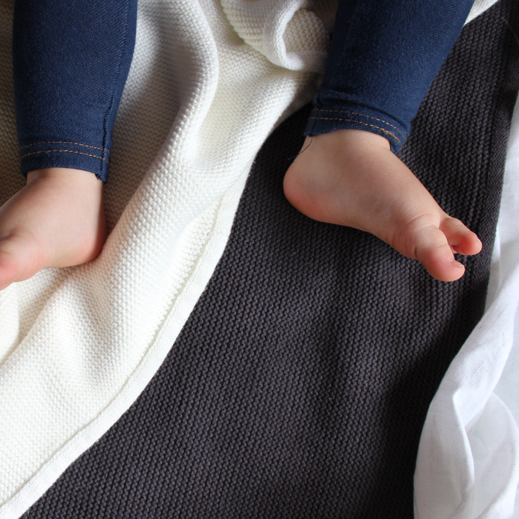 baby feet on charcoal knit blanket