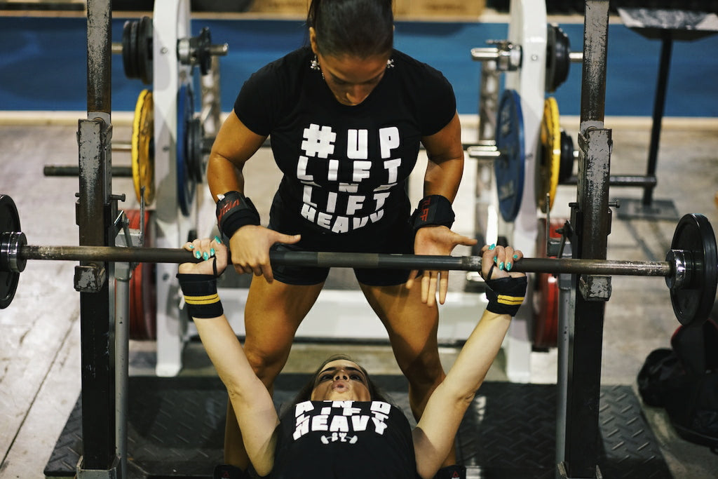 girls bench pressing