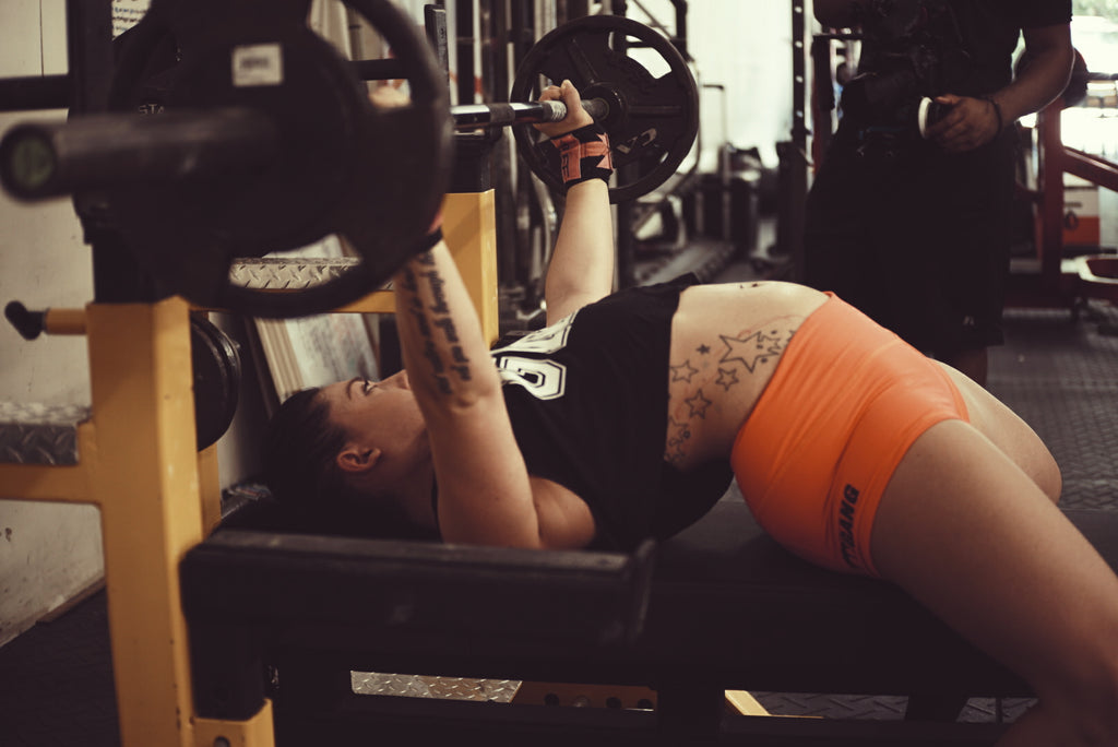 Powerlifting, Girl bench pressing,