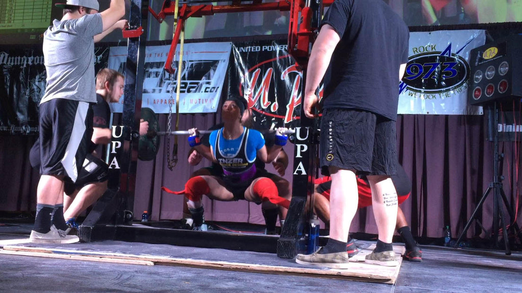 Woman, powerlifter, squatting