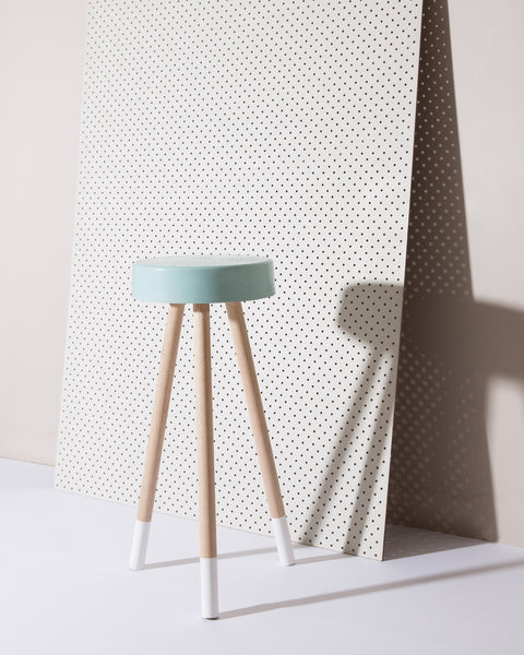 Baby blue concrete stool with raw hardwood legs. Concrete Stool Australia