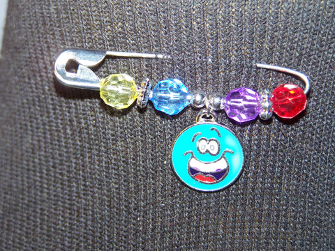 blue smiley face pin