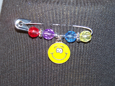 yellow smiley face pin