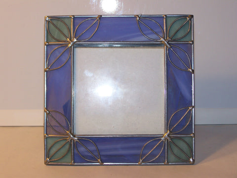 Blue and Green Glass and Metal Frame