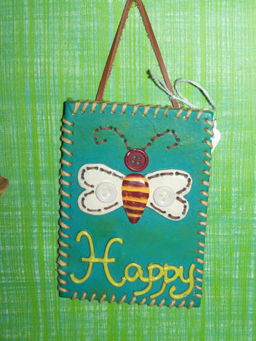 "Ceramic ""happy"" wall hanging"