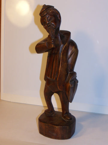 wood Asian man sculpture