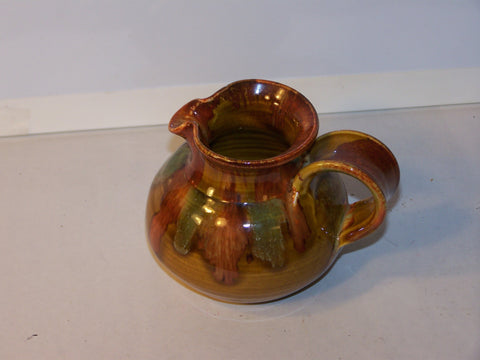 Brown and Green Ceramic Creamer