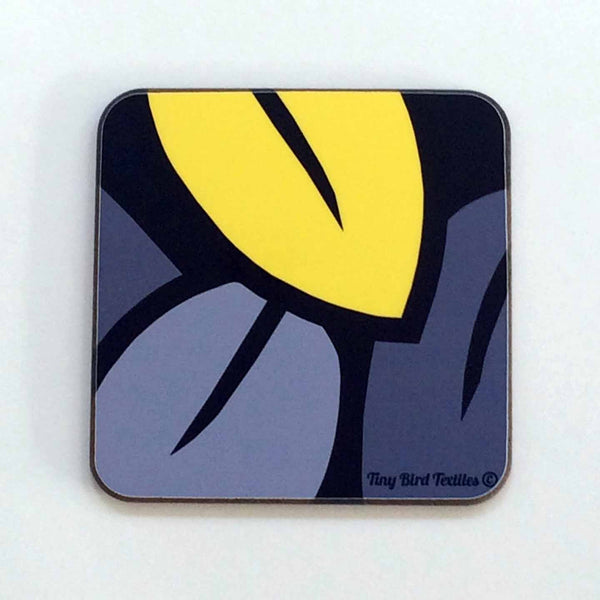 Square drinks mat coaster in grey and yellow Eucalyptus Leaf design, on white background