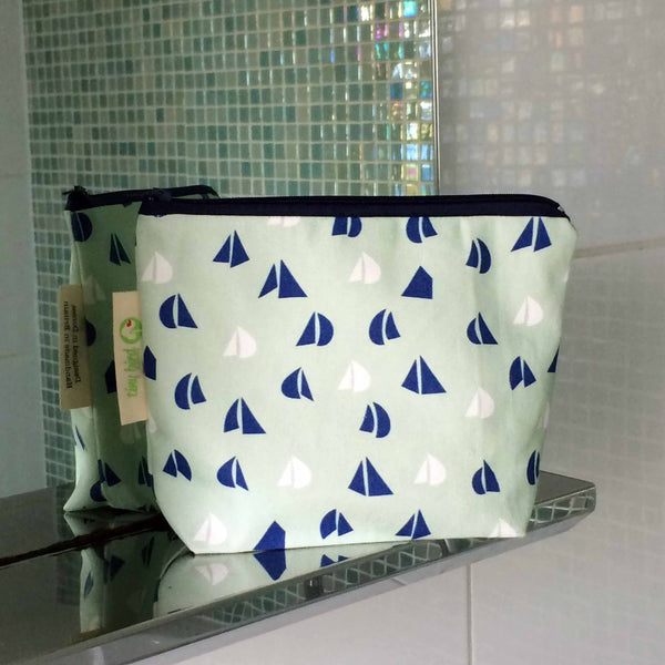 tiny bird textiles close up of rectangle make up bag in sea foam green with blue and white yacht sails on bathroom shelf
