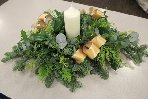 Foliage arrangement with candle