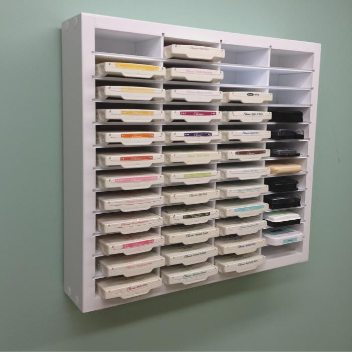 Ink pad storage unit mounted on wall