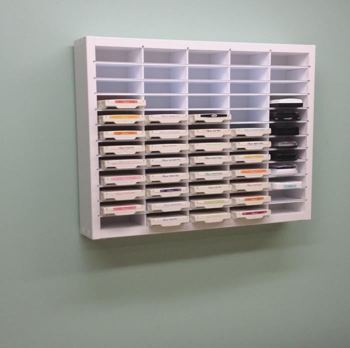 60 Ink Pad Organizer hanging on the wall as if it was in a craft room.